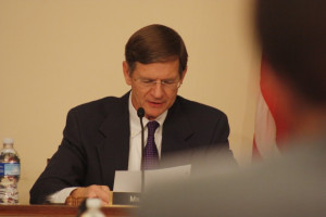 Lamar Smith poring over crap